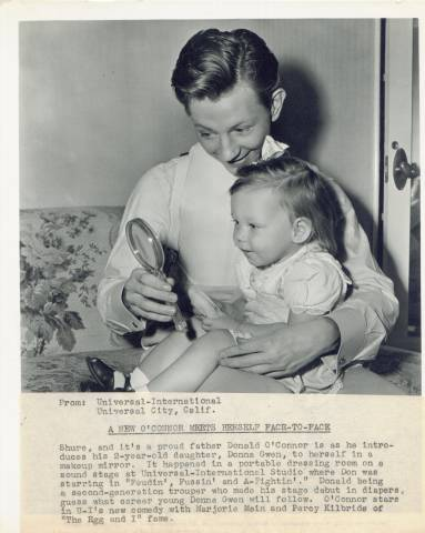 Donald O'Connor press photo with his two-year old daughter