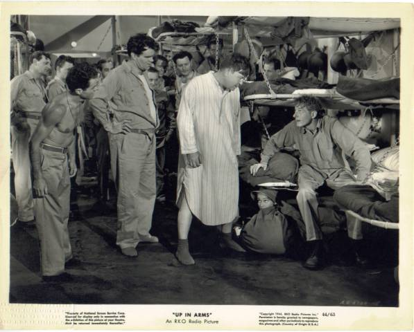Danny Kaye, seated at right, movie still
